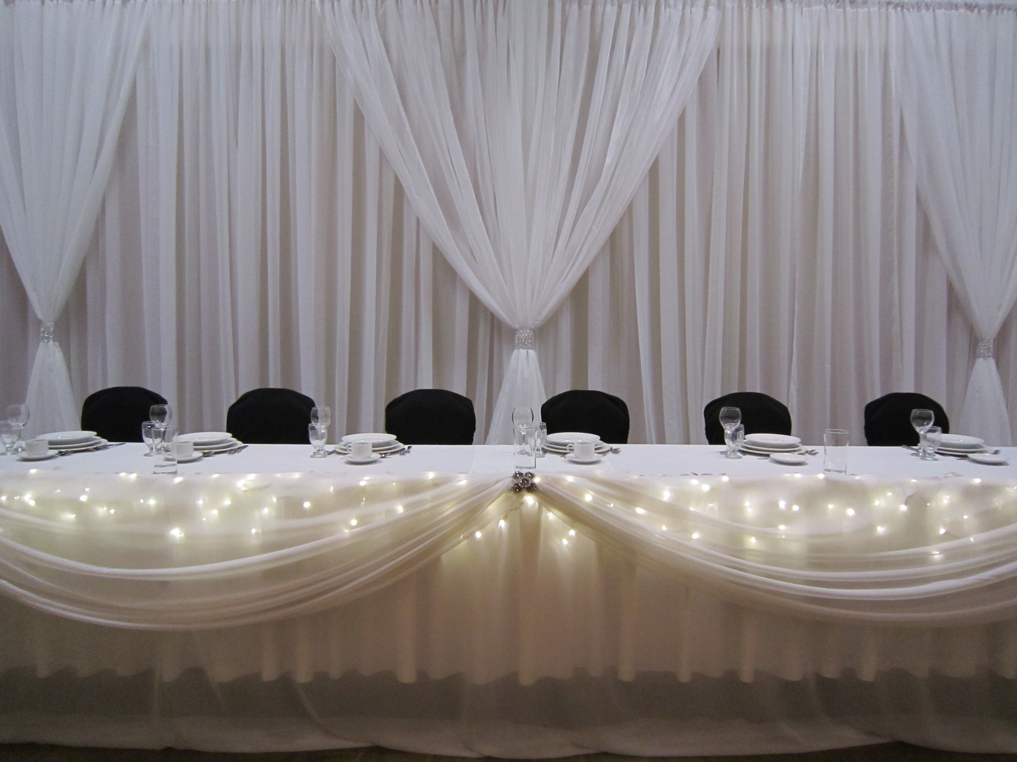 Head table with icicle lights set the mood decor